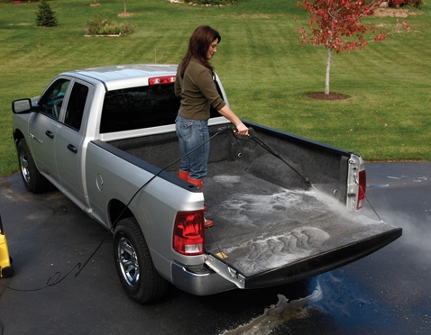 Woman Spraying Down BedRug Bedliner