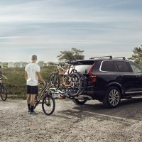 vehicle equipped with a thule roof rack and rear bike rack