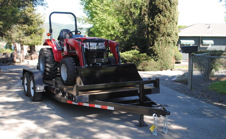 Fabform Tilt Deck Trailer With Tractor Loaded