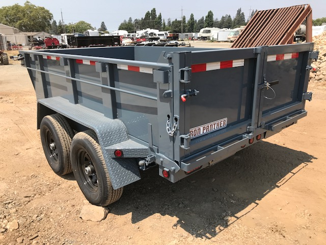 The Iron Panther dump trailer from behind at a worksite