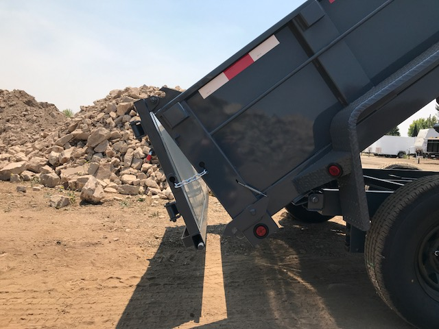 The Iron Panther dump trailer angled up with the spreader gate open