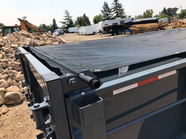 Iron Panther dump trailer with tarp over the top