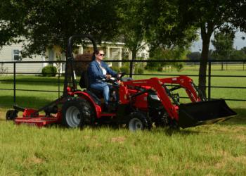 Woman Using Mahindra Max 26 XL Tractor