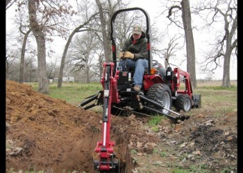 Man Operating Mahindra Max24 Tractor Backhoe