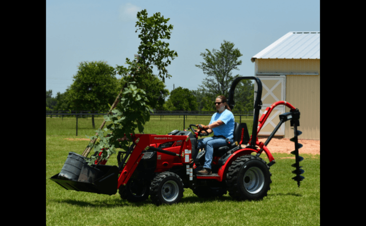 Woman Operating Mahindra Max26 XL Tractor