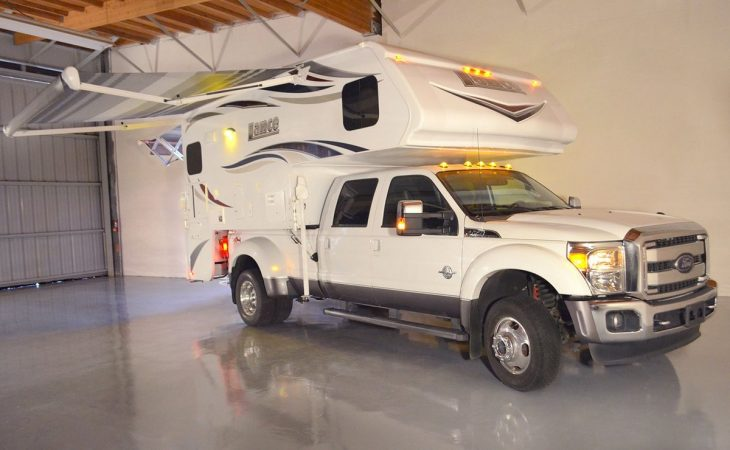 Lance 975 truck camper exterior loaded into pickup truck.