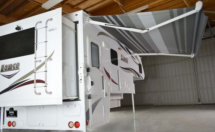 Lance 1172 truck camper exterior view with retractable awning.
