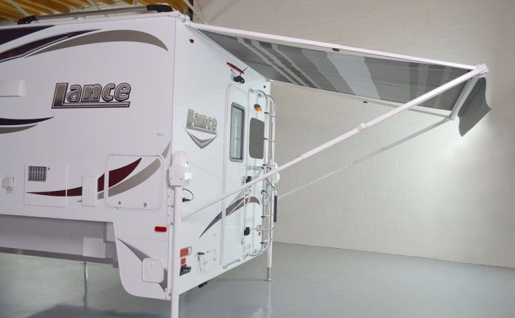 Lance 850 truck camper rear view with canopy.