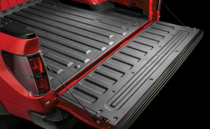 strong textured truck bed liner in red pick-up truck