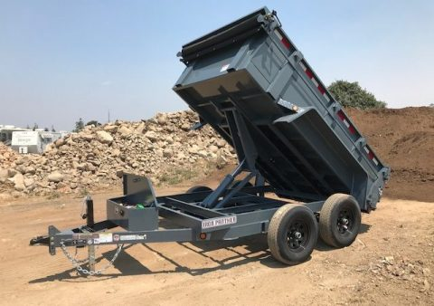 This is a dump trailer with a scissor lift available at Truck Tops USA in Santa Rosa.