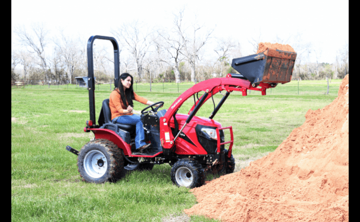 Woman in Mahindra eMax22 Tractor