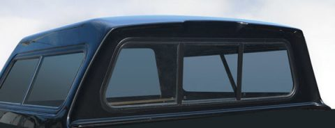 Removable front sliding window for camper shells.