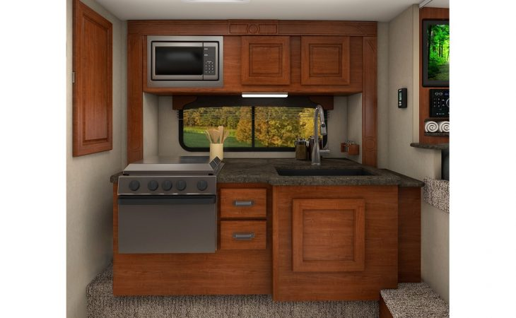 Lance 1062 truck camper kitchenette stove microwave sink.