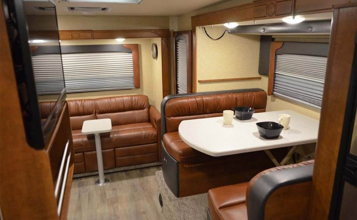 Lance 1172 truck camper full interior view of couch and dinette seating.