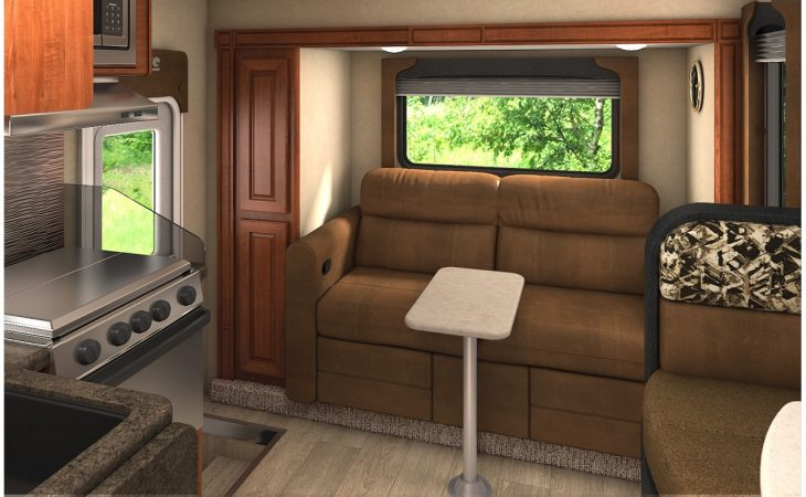 Lance 1172 truck camper fold out couch and bed seating.