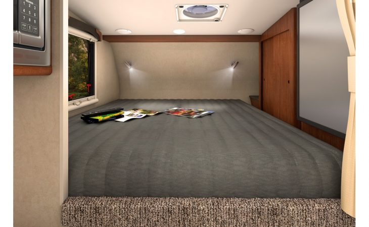 Lance 650 truck camper interior bedroom.