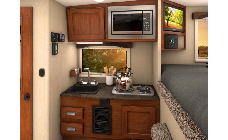 Lance 650 truck camper interior view of kitchenette.
