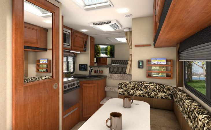 Lance 850 truck camper interior view of kitchenette and dinette.