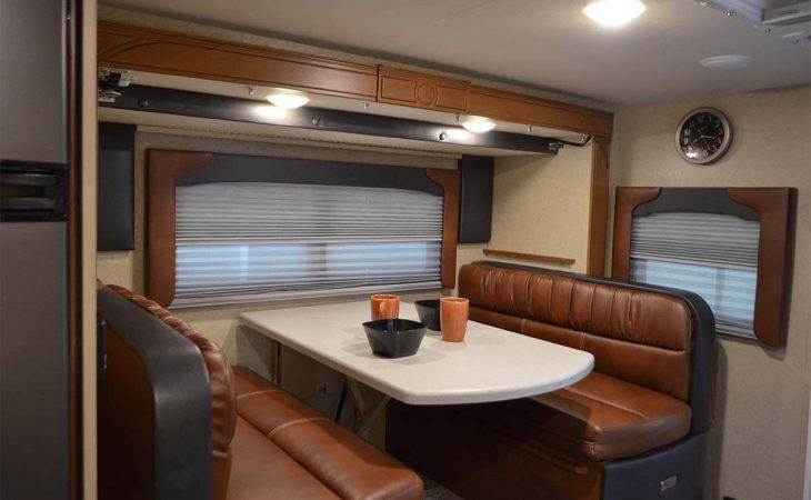 Lance 855s truck camper dinette seating and window.
