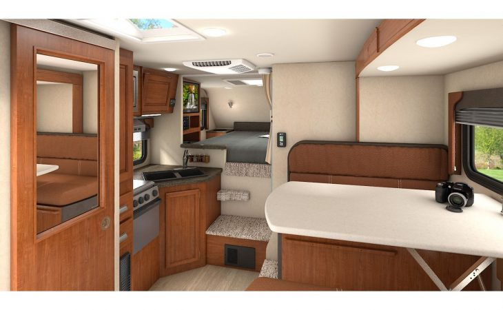 Lance 855s truck camper interior kitchenette and seating.