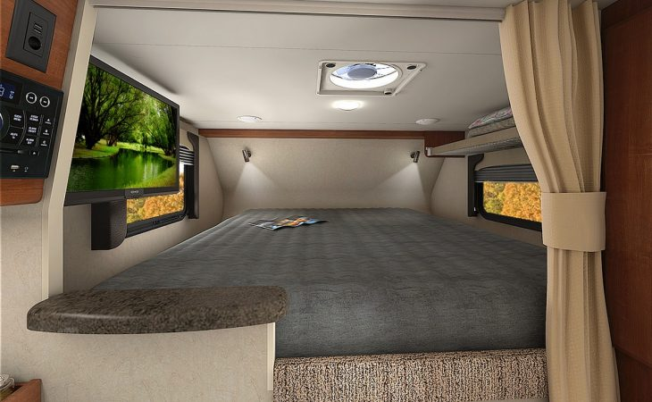Lance 865 truck camper bedroom interior.