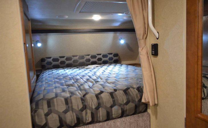 Lance 975 truck camper bedroom interior.