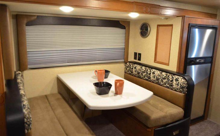 Lance 975 truck camper dinette seating.