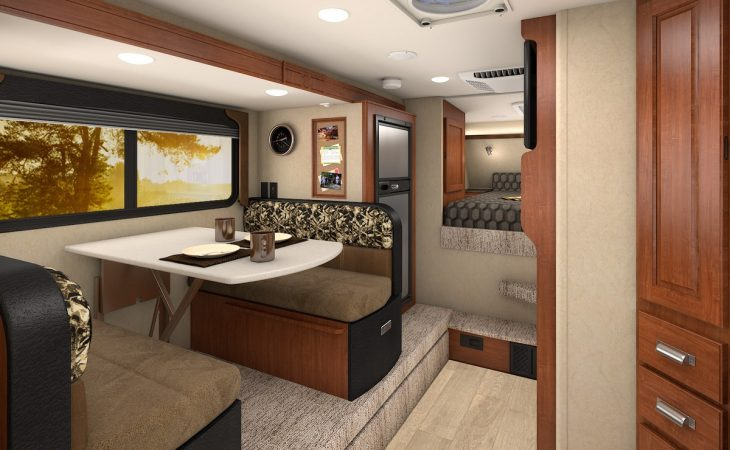 Lance 975 truck camper dinette seating and window view.