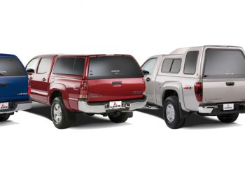 Multiple pickup trucks equipped with leer brand camper shells