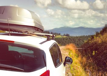 car equipped with Thule roof rack and storage box