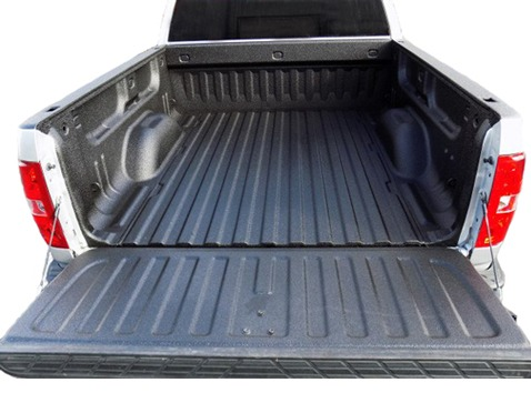 Pickup truck bed with spray on bed liner.