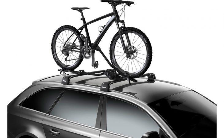 Thule Rooftop Bike Rack installed on a car carrying one bike